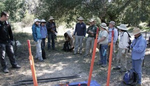 Students gathered for a safety meeting before beginning hands-on training in the USFS BTN Restoration Training class.